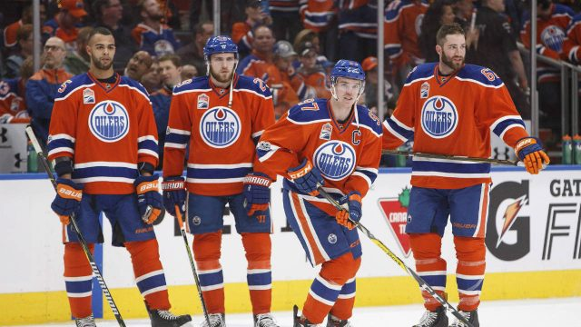 Edmonton-Oilers'-Darnell-Nurse-(25),-Leon-Draisaitl-(29),-Connor-McDavid-(97)-and-Eric-Gryba-(62)-take-part-in-warm-up-before-taking-on-the-San-Jose-Sharks-during-NHL-playoff-action-in-Edmonton,-Alta.,-on-Friday-April-14,-2017.-(Jason-Franson/CP)