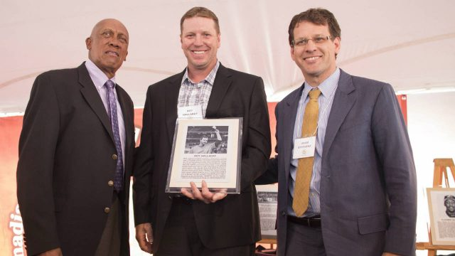 Former-Toronto-Blue-Jays-pitcher-Roy-Halladay-poses-with-Ferguson-Jenkins-(left)-and-Adam-Stevens-during-his-induction-ceremony-at-the-Canadian-Baseball-Hall-of-Fame-in-St.-Mary's,-Ontario,-Saturday,-June-24,-2017.-(Geoff-Robins/CP)