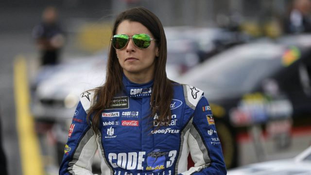 Danica-Patrick-stands-by-her-car-before-qualifying-for-Sunday's-NASCAR-Cup-series-auto-race-at-Charlotte-Motor-Speedway-in-Concord,-N.C.,-Thursday,-May-25,-2017.-(Chuck-Burton/AP)