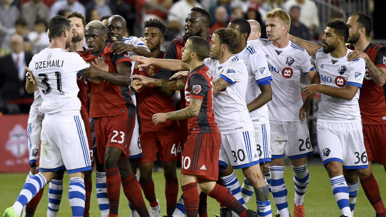 Montreal-Impact's-Blerim-Dzemaili-(31)-and-Toronto-FC-defender-Chris-Mavinga-(23)-trade-words-as-teammates-from-both-camps-swarm-during-second-half-Canadian-Championship-soccer-action-in-Toronto-on-Tuesday,-June-27,-2017.-(Nathan-Denette/CP)