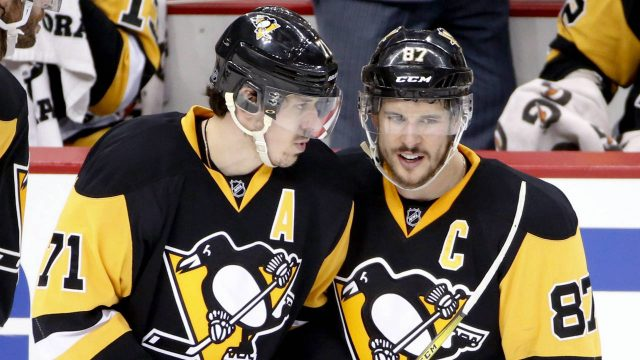 Evgeni-Malkin,-left,-and-Sidney-Crosby.-(Gene-J.-Puskar/AP)