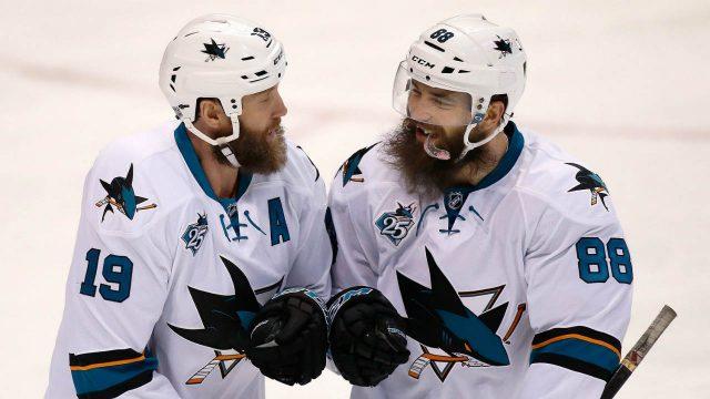 San-Jose-Sharks'-Brent-Burns,-right,-congratulates-teammate-Joe-Thornton.-(Scott-Kane/AP)