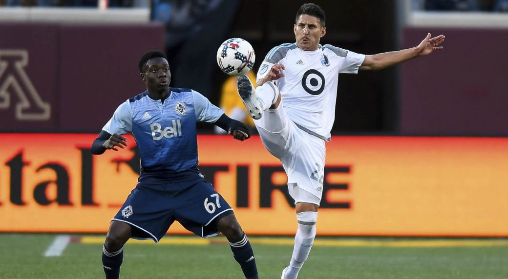 Minnesota-United-defender-Kevin-Venegas,-right,-and-Vancouver-Whitecaps-forward-Alphonso-Davies-(67)-compete-for-the-ball-during-the-second-half-of-an-MLS-soccer-match-Saturday,-June-24,-2017,-in-Minneapolis.-(Aaron-Lavinsky/Star-Tribune-via-AP)