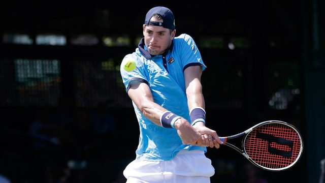Top-seed-John-Isner-returns-the-ball-to-Dennis-Novikov.-(Elise-Amendola/AP)