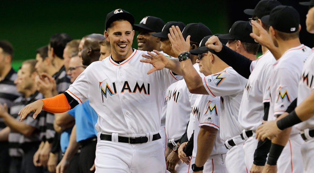 Miami-Marlins-starting-pitcher-Jose-Fernandez-greets-his-teammates-during-a-ceremony-before-an-interleague-opening-day-baseball-game-between-the-Miami-Marlins-and-the-Detroit-Tigers,-in-Miami.-The-Miami-Marlins-begin-their-25th-season-without-their-late-ace,-his-legacy-badly-tarnished-by-recently-disclosed-details-of-his-death,-which-somehow-makes-the-shadow-over-the-franchise-even-darker.-(Alan-Diaz/AP)