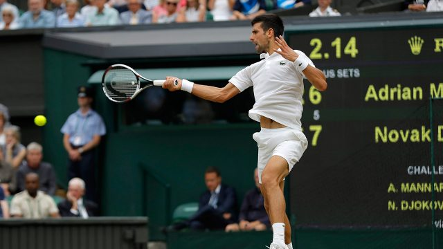 Serbia's-Novak-Djokovic-returns-to-Adrian-Mannarino-of-France-during-their-Men's-Singles-Match-on-day-eight-at-the-Wimbledon-Tennis-Championships-in-London-Tuesday,-July-11,-2017.-(Alastair-Grant/AP)