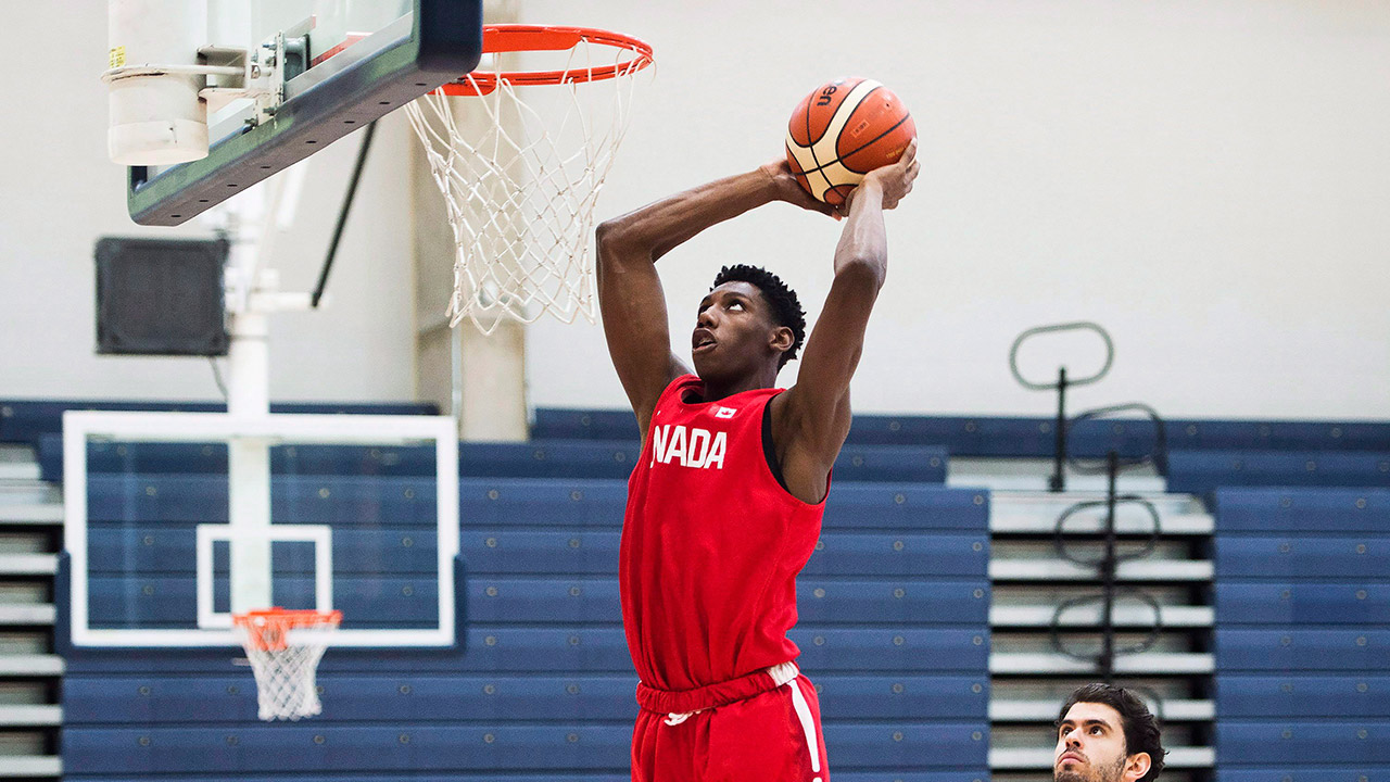 R.J.-Barrett,-17,-slam-dunks-the-ball-during-his-U19-basketball-Canada-team-practice-in-Mississauga,-Ont.,-on-Tuesday,-June-20,-2017.-(Nathan-Denette/AP)