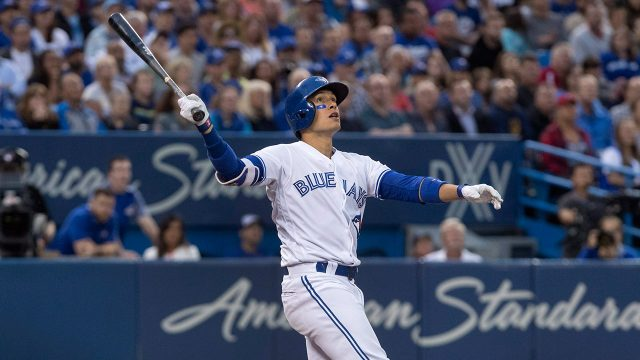Toronto-Blue-Jays-Ryan-Goins-watches-pop-fly-drop-for-a-single.-(Fred-Thornhill/AP)