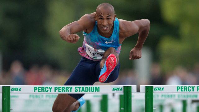 Canada's-Damian-Warner,-of-London,-Ont.,-races-to-a-first-place-finish-in-the-men's-110-metre-hurdles-at-the-Harry-Jerome-International-Track-Classic-in-Coquitlam,-B.C.,-on-Wednesday-June-28,-2017.-(Darryl-Dyck/CP)