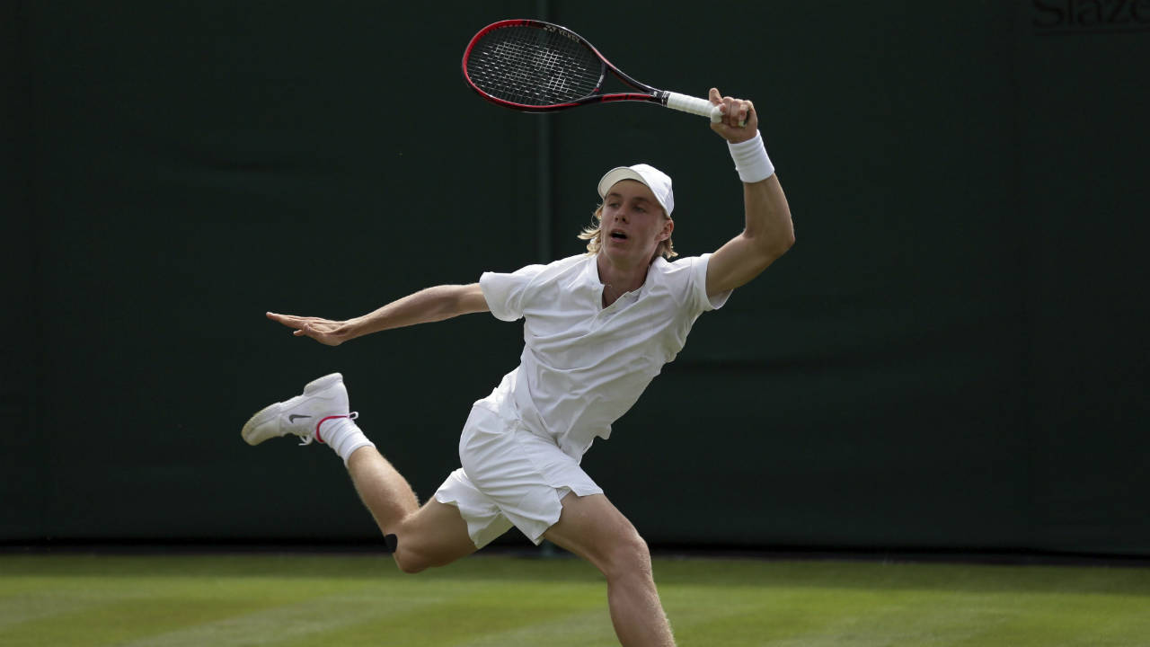 Canada's-Denis-Shapovalov-returns-to-Poland's-Jerzy-Janowicz-during-their-Men's-Singles-Match-on-day-one-at-the-Wimbledon-Tennis-Championships-in-London-Monday,-July-3,-2017.-(Tim-Ireland/AP)