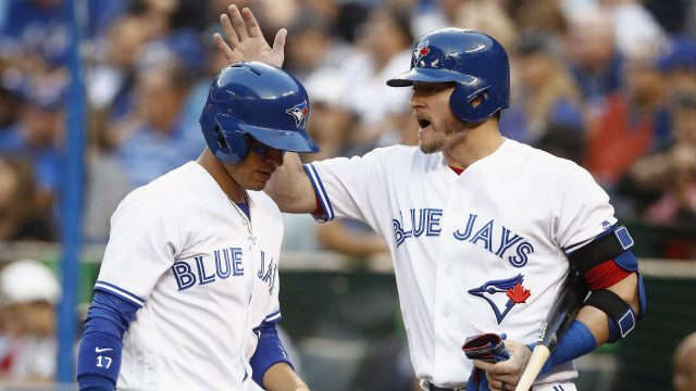Toronto-Blue-Jays'-Josh-Donaldson,-right,-congratulates-teammate-Ryan-Goins-after-scoring-during-second-inning-American-League-MLB-baseball-action-in-Toronto-on-Tuesday,-July-25,-2017.-(Mark-Blinch/CP)