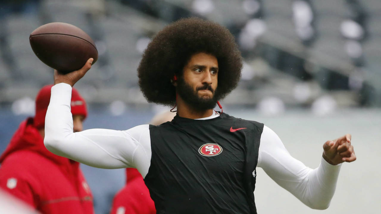 Colin-Kaepernick-warms-up-before-an-NFL-football-game-against-the-Chicago-Bears.-(Charles-Rex-Arbogast,-File/AP)
