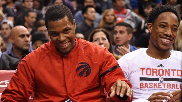 Toronto-Raptors-guard-Kyle-Lowry-(7),-left,-and-DeMar-DeRozan-(10)-share-a-laugh-on-the-bench.-(Frank-Gunn/CP)