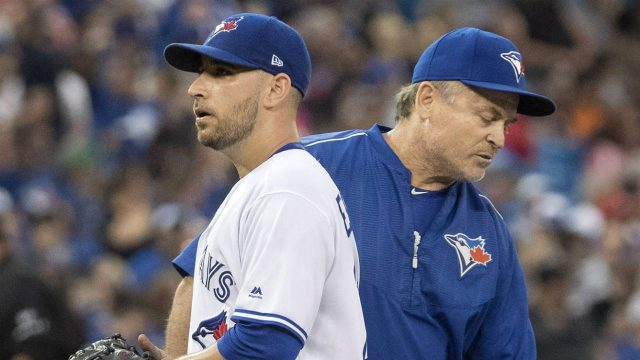 Manager-John-Gibbons-pulls-Toronto-Blue-Jays-starting-pitcher-Marco-Estrada-out-of-the-game-during-fifth-inning-AL-baseball-action-against-the-Boston-Red-Sox,-in-Toronto-on-Friday,-June-30,-2017.-(Fred-Thornhill/CP)