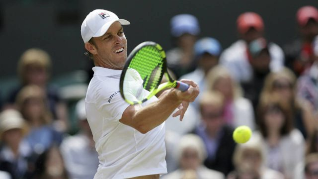 Sam-Querrey-of-the-United-States-returns-to-Britain's-Andy-Murray-during-their-Men's-Singles-Quarter-final-Match-on-day-nine-at-the-Wimbledon-Tennis-Championships-in-London-Wednesday,-July-12,-2017.-(Tim-Ireland/AP)