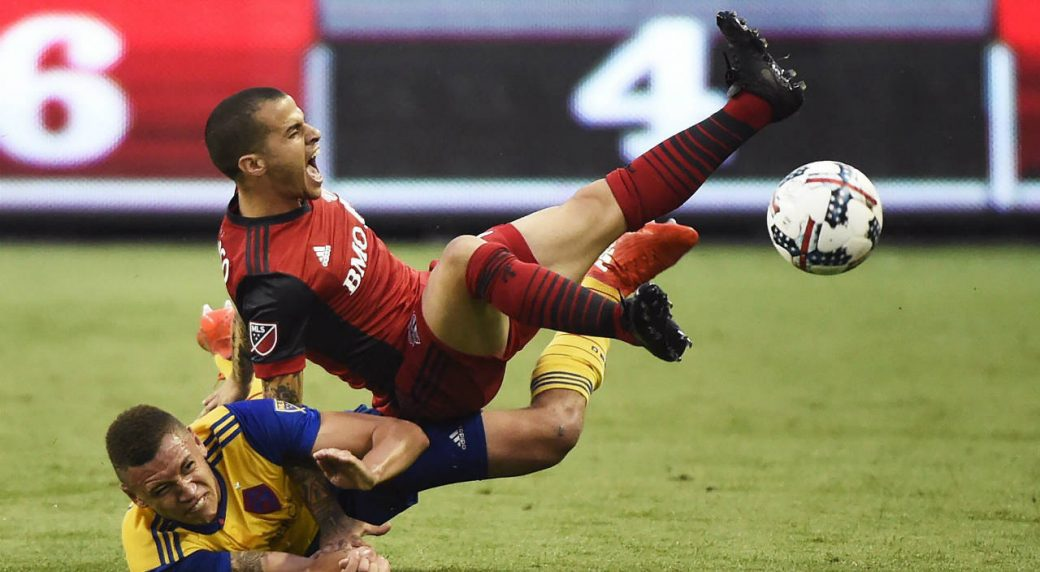 Colorado-Rapids-defender-Kortne-Ford-(24)-and-Toronto-FC-forward-Sebastian-Giovinco-(10)-battle-for-the-ball-during-second-half-MLS-soccer-action-in-Toronto-on-Saturday,-July-22,-2017.-(Nathan-Denette/CP)