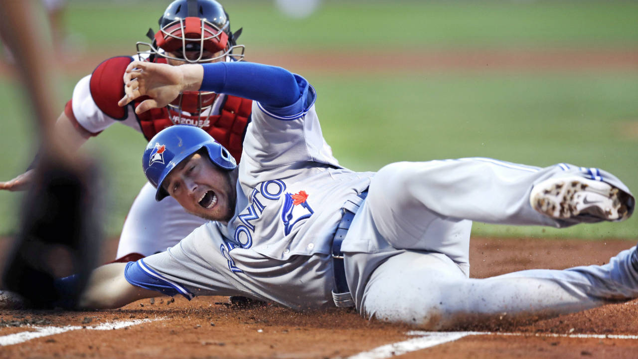 Toronto-Blue-Jays'-Justin-Smoak-beats-the-tag-by-Boston-Red-Sox-catcher-Christian-Vazquez-to-score-on-a-two-run-double-by-Kendrys-Morales-during-the-first-inning-of-a-baseball-game-at-Fenway-Park-in-Boston,-Monday,-July-17,-2017.-(Charles-Krupa/AP)