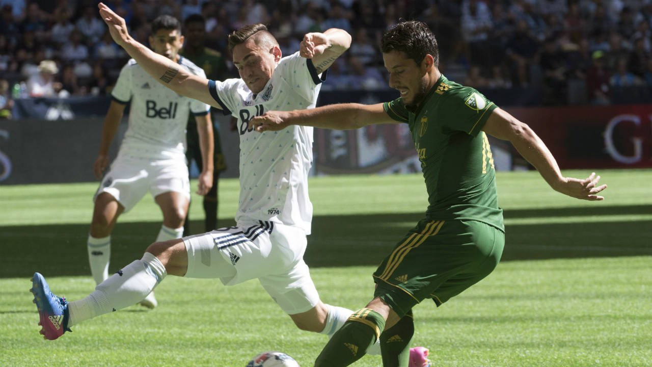 Vancouver-Whitecaps-defender-Jake-Nerwinski-(28)-fights-for-control-of-the-ball-with-Portland-Timbers-midfielder-Sebastian-Blanco-(10)-during-the-first-half-of-MLS-soccer-action-in-Vancouver-on-Sunday,-July,-23,-2017.-(Jonathan-Hayward/CP)