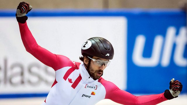 Charles-Hamelin-of-Canada-celebrates-during-the-men's-1,500-meters-final-race.-(Jens-Meyer/AP)