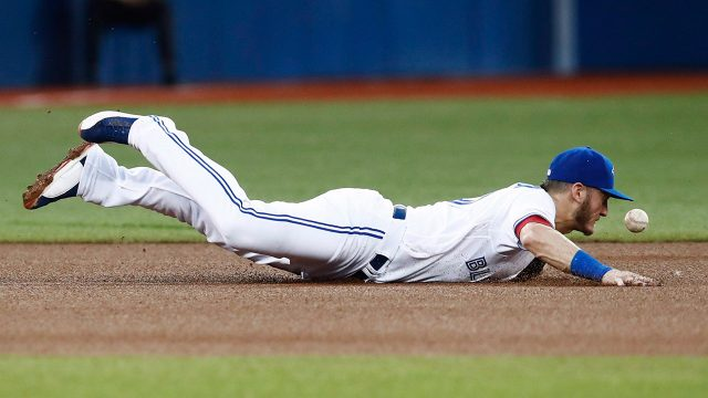 Toronto-Blue-Jays'-Josh-Donaldson-dives-after-a-ball-against-the-New-York-Yankees.-(Mark-Blinch/AP)