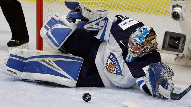 Finland-goalie-Noora-Raty-deflects-a-shot-during-the-first-period.-(Carlos-Osorio/AP)