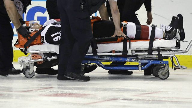 Arizona-Coyotes-centre-Alexander-Burmistrov-(91)-is-taken-off-the-ice-on-a-stretcher-following-a-hit-by-Boston-Bruins-defenceman-Colin-Miller-during-the-second-period-of-an-NHL-hockey-game-in-Boston,-Tuesday,-Feb.-28,-2017.-(Charles-Krupa/AP)