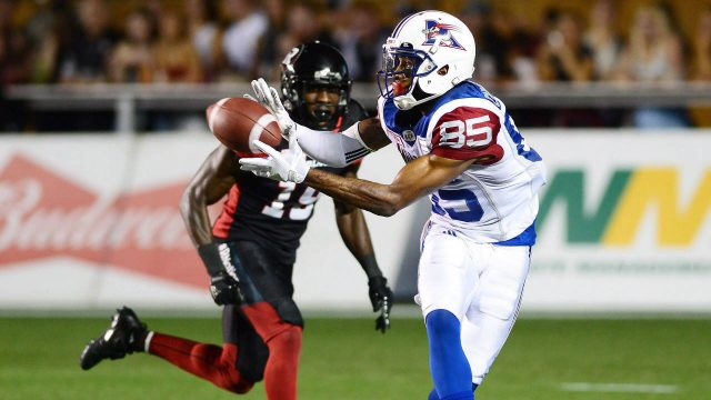 Montreal-Alouettes-wide-receiver-B.J.-Cunningham-(85)-makes-a-catch-in-front-of-Ottawa-Redblacks-defensive-back-Imoan-Claiborne-(19)-during-second-half-CFL-football-action-in-Ottawa-on-Wednesday,-July-19,-2017.-(Sean-Kilpatrick/CP)
