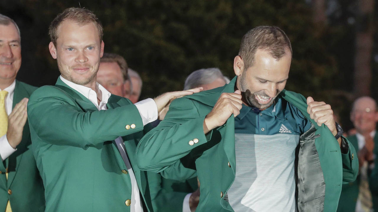 Danny-Willett-of-England,-puts-a-green-jacket-on-Sergio-Garcia,-of-Spain,-after-the-Masters-golf-tournament,-Sunday,-April-9,-2017,-in-Augusta,-Ga.-(Chris-Carlson/AP)