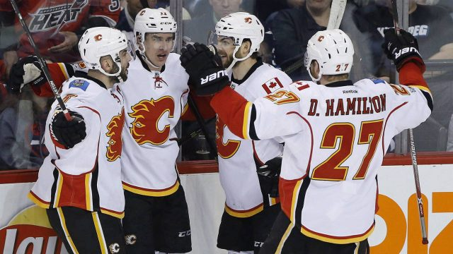Calgary-Flames'-Mark-Giordano-(5),-Mikael-Backlund-(11),-Michael-Frolik-(67)-and-Dougie-Hamilton-(27)-celebrate-Backlund's-goal-during-first-period-NHL-action-against-the-Winnipeg-Jets-in-Winnipeg-on-Saturday,-March-11,-2017.-(John-Woods/CP)