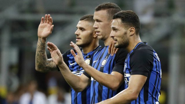 Inter-Milan's-Ivan-Perisic,-centre,-celebrates-with-his-teammates-Mauro-Icardi,-left,-and-Danilo-D'Ambrosio-after-scoring-during-the-Serie-A-soccer-match-between-Inter-Milan-and-Fiorentina-at-the-San-Siro-stadium-in-Milan,-Italy,-Sunday,-Aug.-20,-2017.-(Antonio-Calanni/AP)