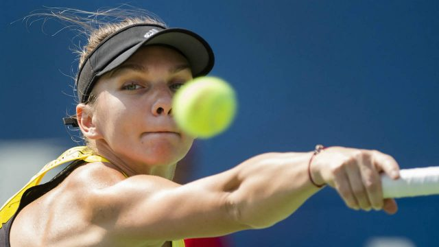 Simona-Halep-of-Romania-returns-the-ball-against-Barbora-Strycova-of-the-Czech-Republic-during-women's-third-round-Rogers-Cup-tennis-action-in-Toronto-on-Thursday,-August-10,-2017.-(Nathan-Denette/CP)