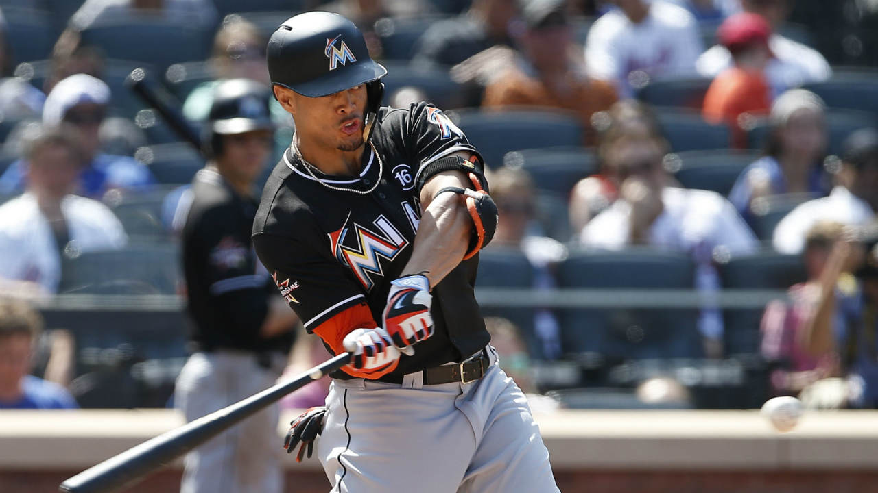 Miami-Marlins'-Giancarlo-Stanton-hits-a-three-run-home-run-against-the-New-York-Mets-during-the-seventh-inning-of-a-baseball-game,-Sunday,-Aug.-20,-2017,-in-New-York.-(Rich-Schultz/AP)