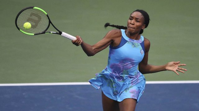 Venus-Williams-returns-to-Canada's-Genie-Bouchard-in-a-special-women's-exhibition-tennis-match-at-the-BB&T-Atlanta-Open-Tournament,-Sunday,-July-23,-2017,-in-Atlanta.-(Curtis-Compton/Atlanta-Journal-Constitution-via-AP)