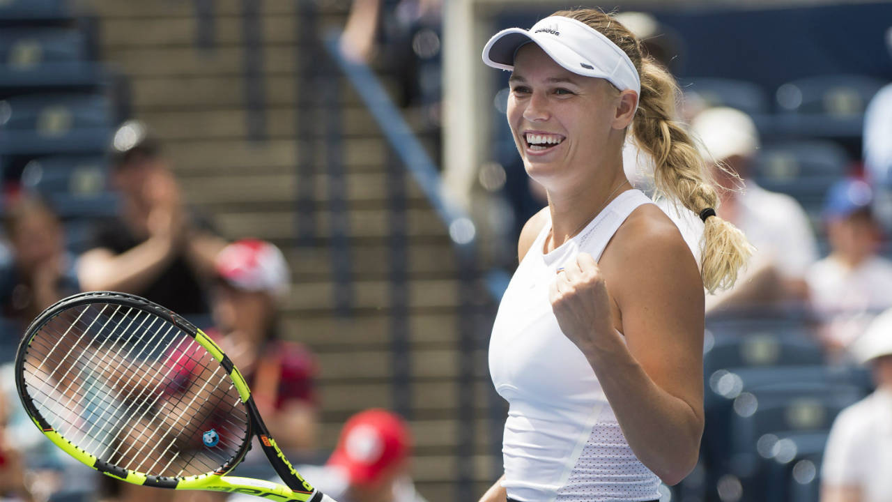 Caroline-Wozniacki,-of-Denmark,-reacts-after-defeating-Sloane-Stephens,-of-the-United-States,-advancing-to-the-finals-during-women's-semi-final-Rogers-Cup-tennis-action-in-Toronto-on-Saturday,-August-12,-2017.-(Nathan-Denette/CP)