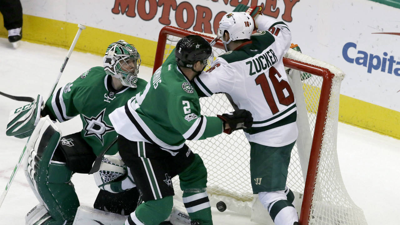 Dallas-Stars-goalie-Kari-Lehtonen,-left,-of-Finland,-watches-as-defenceman-Dan-Hamhuis-(2)-and-Minnesota-Wild-left-wing-Jason-Zucker-(16)-crash-into-the-net-after-a-goal-scored-by-Zucker-in-the-third-period-of-an-NHL-hockey-game-in-Dallas,-Saturday-Jan.-14,-2017.-The-goal-gave-the-Wild-the-win.-(LM-Otero/AP)