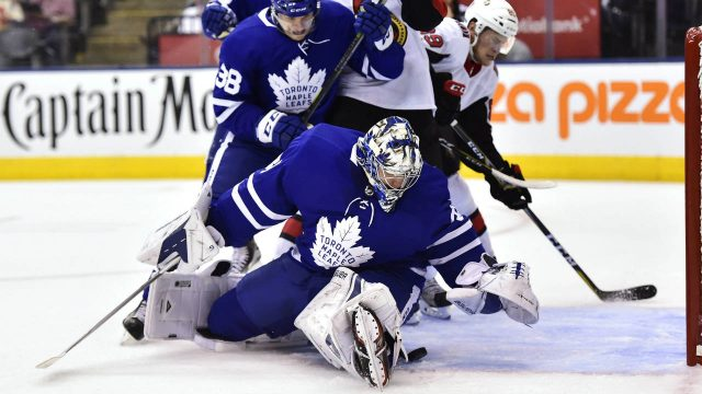 Toronto-Maple-Leafs-goalie-Frederik-Andersen-(31)-looks-for-the-puck-as-Maple-Leafs-left-wing-Colin-Greening-(38)-and-Ottawa-Senators-centre-Tom-Pyatt-(10)-battle-during-first-period-NHL-pre-season-action-in-Toronto-on-Tuesday,-September-19,-2017.-(Frank-Gunn/CP)
