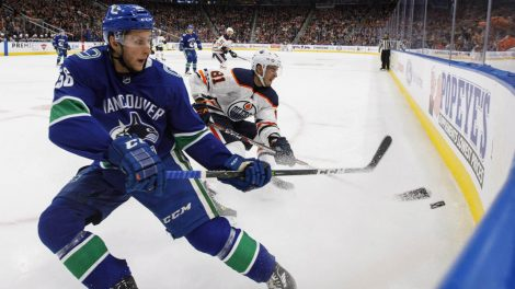 Vancouver-Canucks'-Guillaume-Brisebois-(56)-and-Edmonton-Oilers'-Yohann-Auvitu-(81)-battle-for-the-puck-during-second-period-pre-season-NHL-action-in-Edmonton,-Alta.,-on-Friday-September-22,-2017.-(Jason-Franson/CP)