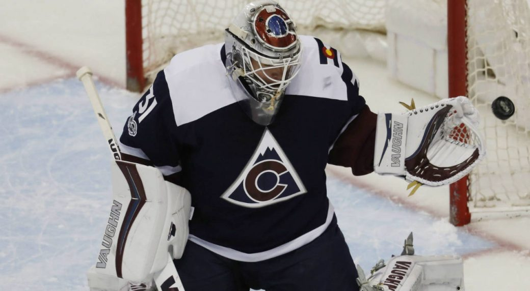 Colorado-Avalanche-goalie-Calvin-Pickard-reaches-out-to-stop-a-shot-off-the-stick-of-a-St.-Louis-Blues-player-in-the-first-period-of-an-NHL-hockey-game-Friday,-March-31,-2017,-in-Denver.-(David-Zalubowski/AP)