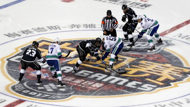 Players-of-the-Los-Angeles-Kings,-and-the-Vancouver-Canucks-fight-for-the-puck-during-the-NHL-China-pre-season-hockey-game-at-Mercedes-Benz-Arena-in-Shanghai,-China,-Thursday,-Sept.-21,-2017.-(AP-Photo)