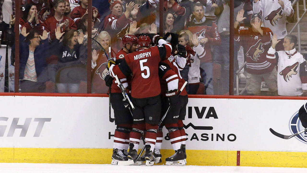 Arizona-Coyotes'-Connor-Murphy-(5),-Boyd-Gordon-(15)-and-Nicklas-Grossmann,-left,-of-Sweden,-surround-Jordan-Martinook-after-his-goal-against-against-the-Pittsburgh-Penguins-during-the-second-period-of-an-NHL-hockey-game-Saturday,-Oct.-10,-2015,-in-Glendale,-Ariz.-(Ross-D.-Franklin/AP)