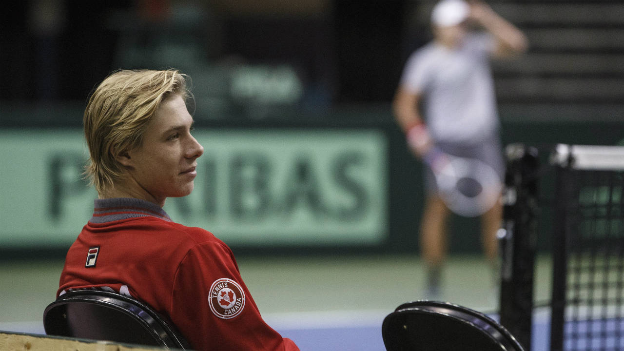 Canada's-Denis-Shapovalov-watches-as-a-teammate-practises-after-a-Davis-Cup-press-conference-in-Edmonton,-Alta.,-on-Tuesday,-September-12,-2017.-(Jason-Franson/CP)