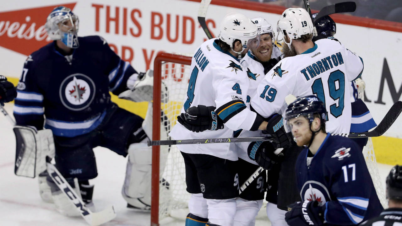 San-Jose-Sharks'-Brenden-Dillon-(4),-Joe-Pavelski-(8)-and-Joe-Thornton-(19)-celebrate-after-Pavelski-scored-on-Winnipeg-Jets-goaltender-Connor-Hellebuyck-(37)-during-first-period-NHL-hockey-action-in-Winnipeg,-Monday,-March-6,-2017.-(Trevor-Hagan/CP)