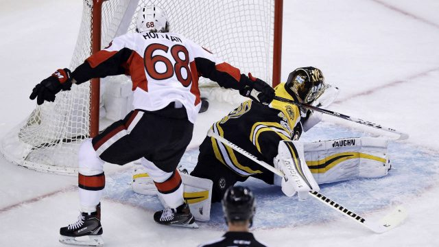 Ottawa-Senators-left-wing-Mike-Hoffman-(68)-tips-the-puck-past-Boston-Bruins-goalie-Tuukka-Rask-(40)-for-a-goal-as-he-skates-past-during-the-first-period-in-Game-3-of-a-first-round-NHL-hockey-playoff-series-in-Boston,-Monday,-April-17,-2017.-(Charles-Krupa/AP)