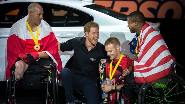 Prince-Harry-laughs-with-medalists-in-indoor-rowing-at-the-Invictus-Games-in-Toronto-on-Tuesday,-Sept.-26,-2017.-(Chris-Donovan/CP)