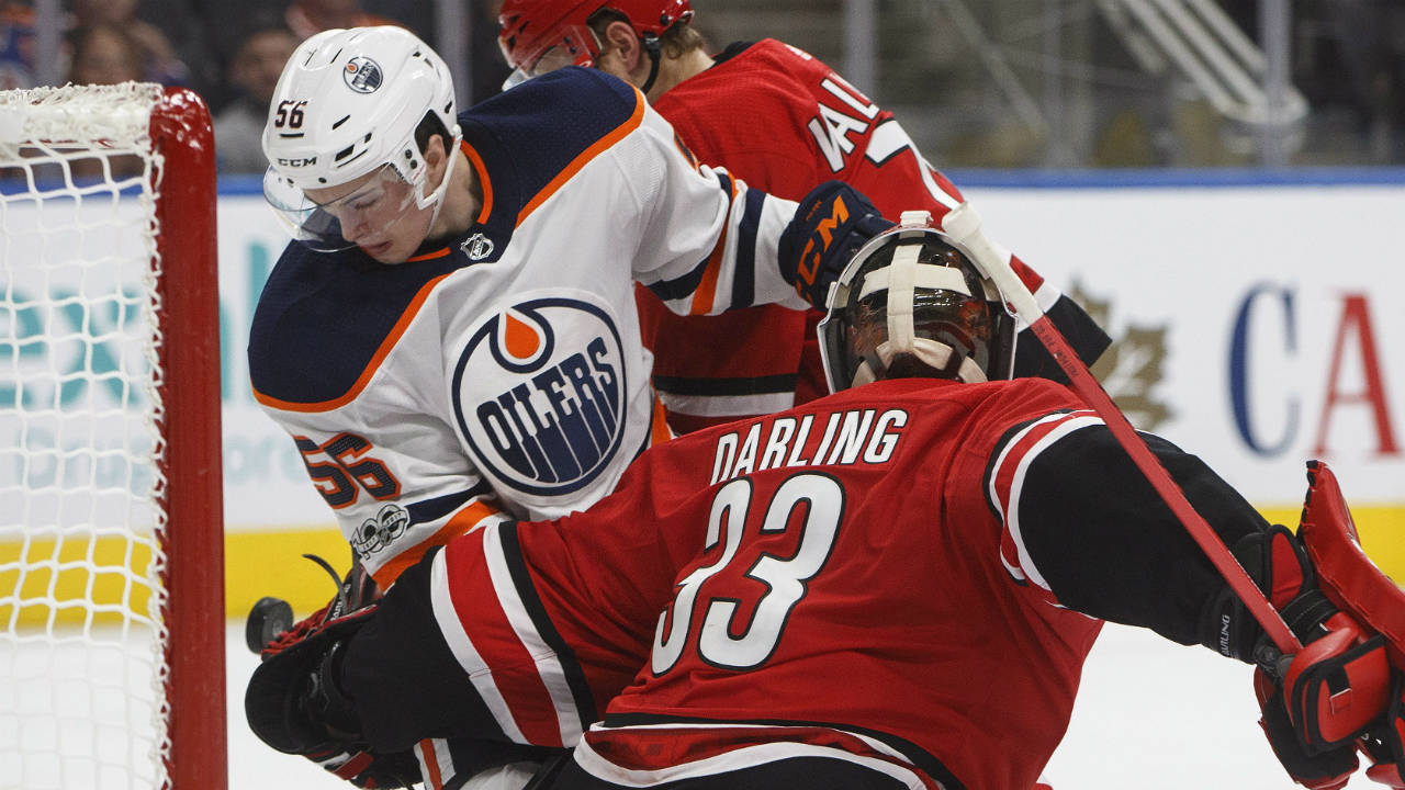 Carolina-Hurricanes-goalie-Scott-Darling-(33)-makes-the-save-as-Edmonton-Oilers'-Kailer-Yamamoto-(56)-looks-for-the-rebound-during-second-period-preseason-NHL-action-in-Edmonton,-Alta.,-on-Monday-September-25,-2017.-(Jason-Franson/CP)