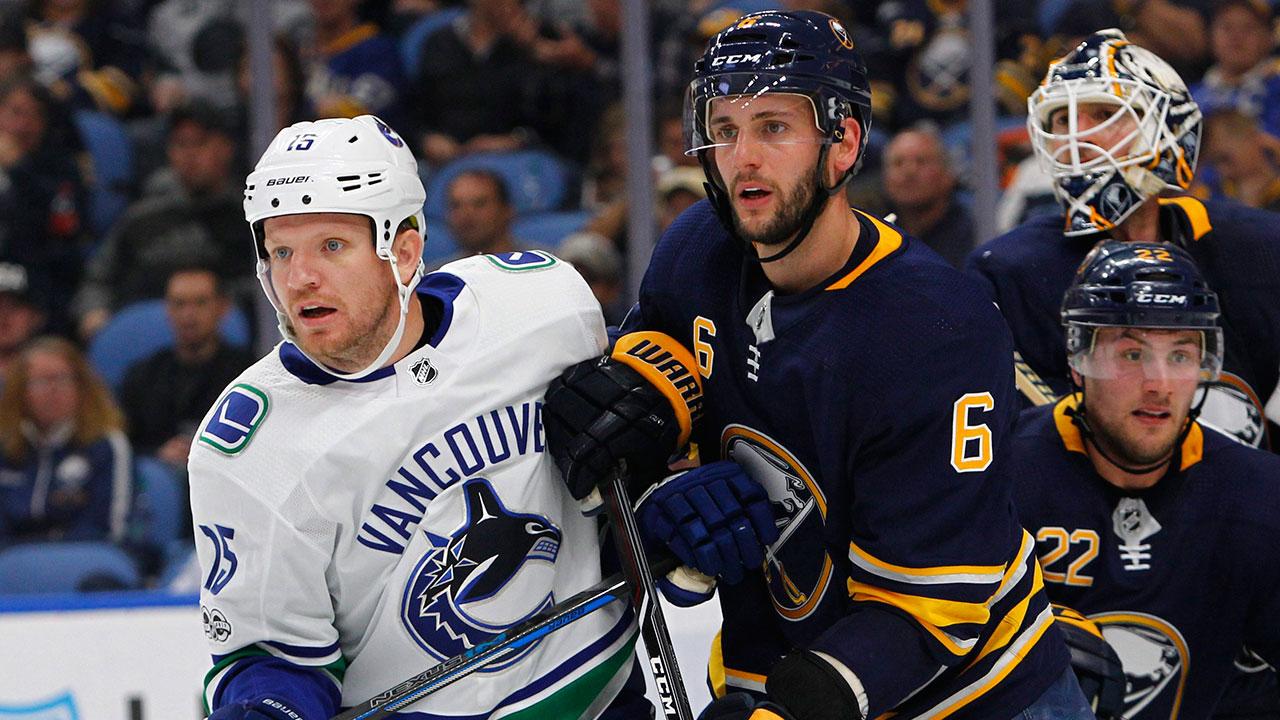 Buffalo-Sabres-defenceman-Marco-Scandella-(6)-and-Vancouver-Canucks-forward-Derek-Dorsett.-(Jeffrey-T.-Barnes/AP)