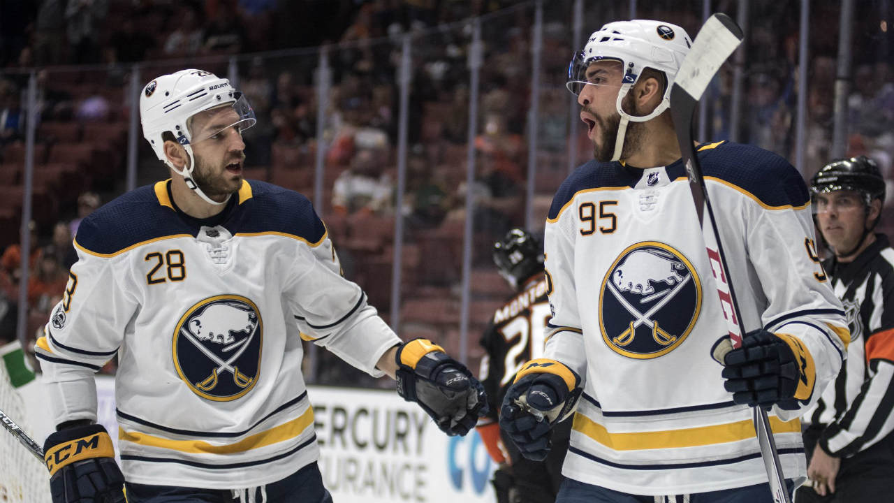 Buffalo-Sabres-right-wing-Justin-Bailey,-right,-celebrates-his-goal-with-center-Zemgus-Girgensons-during-the-first-period-of-an-NHL-hockey-game-against-the-Anaheim-Ducks,-in-Anaheim,-Calif.,-Sunday,-Oct.-15,-2017.-(Kyusung-Gong/AP)