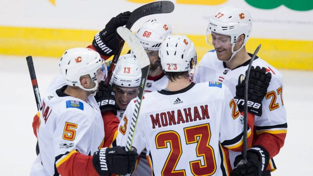 Calgary-Flames'-Mark-Giordano,-from-left-to-right,-Johnny-Gaudreau,-Jaromir-Jagr,-of-the-Czech-Republic,-Sean-Monahan-and-Dougie-Hamilton-celebrate-Monahan's-goal-during-second-period-NHL-hockey-action-against-the-Vancouver-Canucks,-in-Vancouver-on-Saturday,-October-14,-2017.-(Darryl-Dyck/CP)