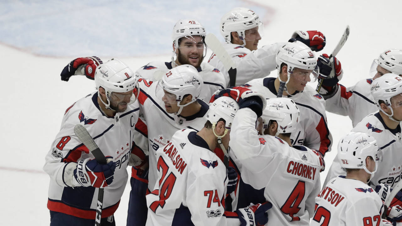 Washington-Capitals-left-wing-Alex-Ovechkin-(8)-is-congratulated-by-teammates-after-scoring-the-winning-goal-in-overtime-of-an-NHL-hockey-game-against-the-Detroit-Red-Wings,-Friday,-Oct.-20,-2017,-in-Detroit.-(Carlos-Osorio/AP)