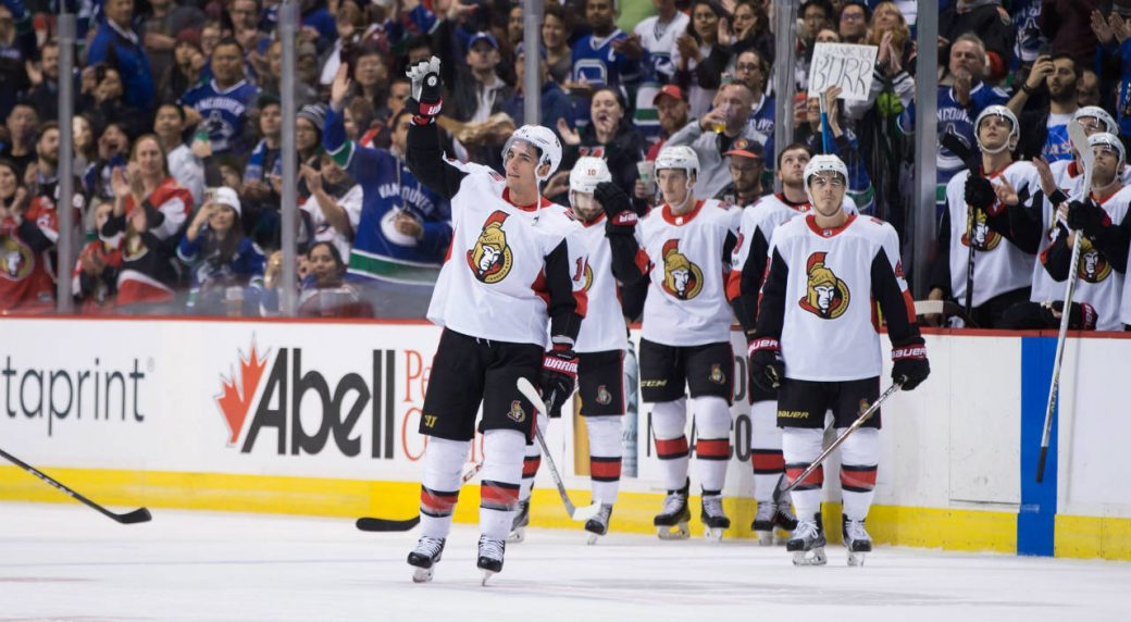 Ottawa-Senators'-Alex-Burrows,-front,-acknowledges-a-standing-ovation-from-the-crowd-after-a-video-tribute-was-played-for-him-by-his-former-team,-the-Vancouver-Canucks,-during-first-period-NHL-hockey-action-in-Vancouver-on-Tuesday,-October-10,-2017.-(Darryl-Dyck/CP)